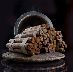 elite cigars are stored in oak barrels