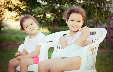 two little girls in garden