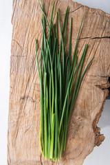 Fototapeta Fresh green chives on wooden board obraz