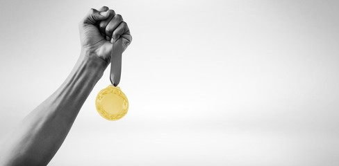 Hand holding a silver medal
