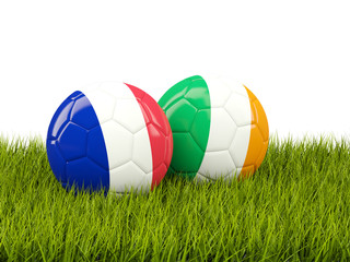 France and Ireland soccer balls on grass