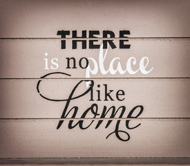There is no place like home - title on the wooden background