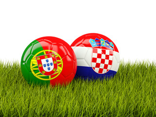 Portugal and Croatia soccer balls on grass