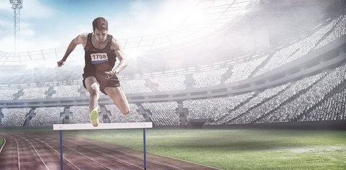 Composite image of sportsman practising hurdles