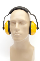 yellow earmuffs on white background