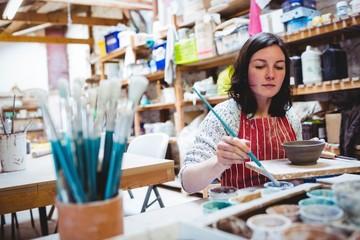 Potter working in workshop