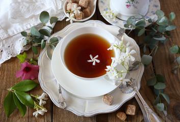 Vintage style: romantic tea drinking with jasmine tea