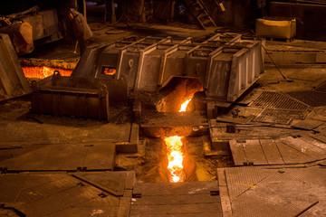 Steelworker near a blast furnace