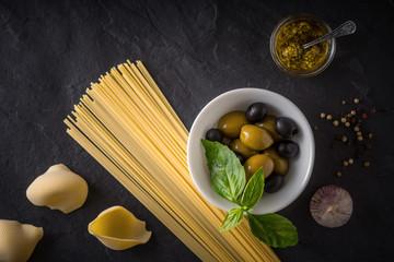Italian food mix on the black stone table