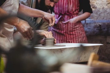 Cropped image of potters working