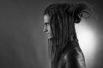 Young man's portrait. Stylish handsome sexy Guy with Dreadlocks