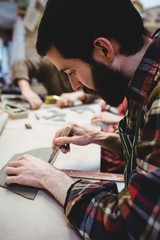 Bearded man working at workshop