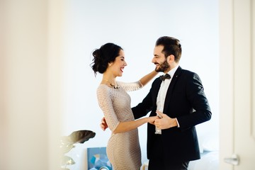 Stylish young couple dancing at home before night out