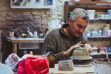 Mature male potter working