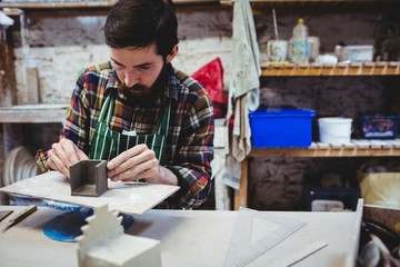 Concentrated man working at workshop