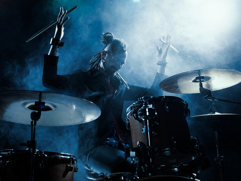 Silhouette of the drummer on stage.