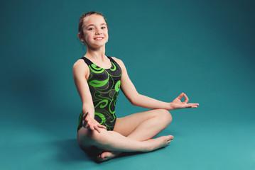 little girl acrobat. exercises. fitness