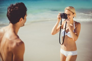 Woman taking picture of her man