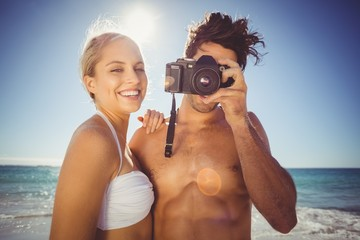 Couple clicking photographs from camera