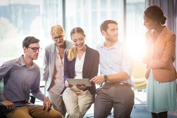 Business people interacting using digital tablet