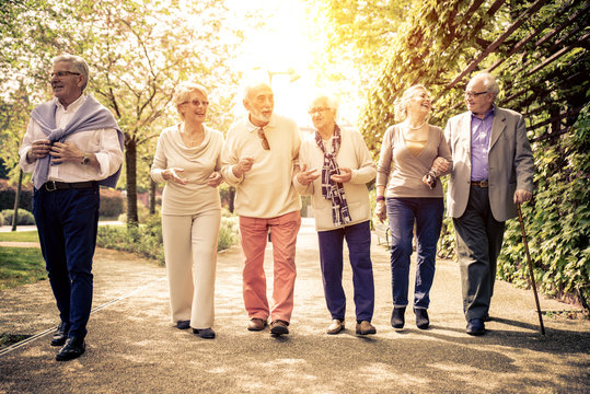 Group of old people walking outdoor