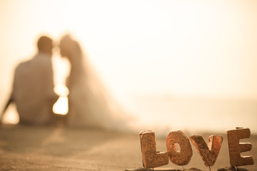The Lover on wedding couple and sunset background with vintage tone