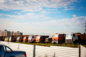 Dump trucks on construction site.