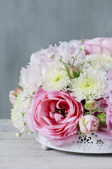 Floral arrangement with pink peonies, tiny roses, chrysanthemums