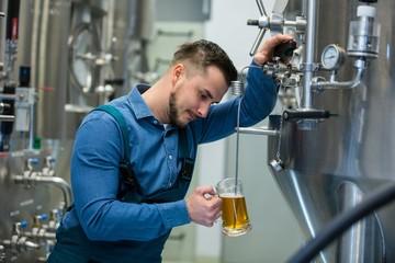 Brewer testing beer