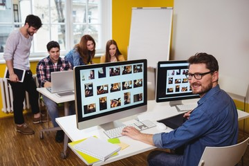 Portrait of male photo editor working on computer