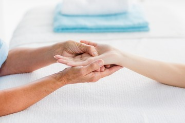Cropped image of woman receiving hand massage