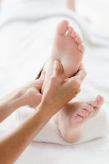 Cropped image of woman receiving foot massage