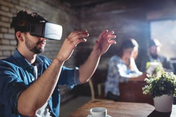 Man using virtual headset at cafe