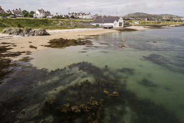 Clear waters and sandy beach at Holyhead on Anglesey, Wales, UK