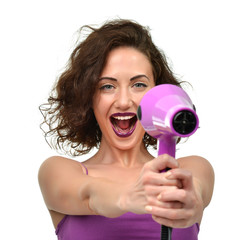 Happy young woman with purple hair dryer pointing at the camera