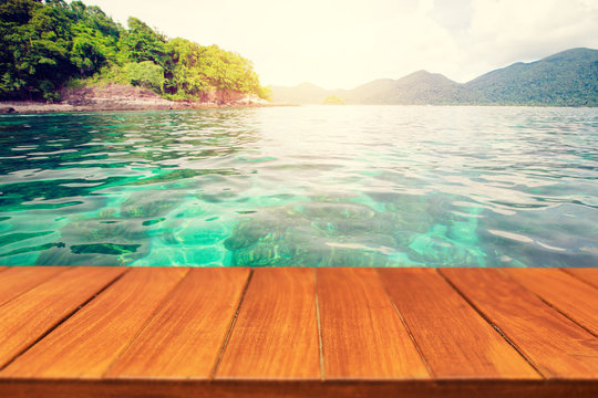 Wood table top on beautiful tropical sea background. For display and montage products