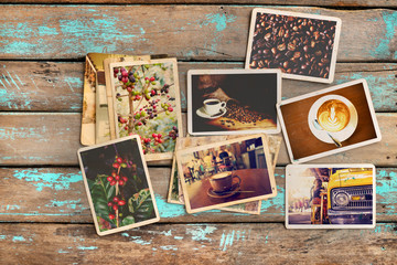 Coffee photo album on wood table. instant photo of classic film camera - vintage and retro style