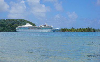 Cruise ship near a tropical islet, Huahine island, Pacific ocean, French Polynesia