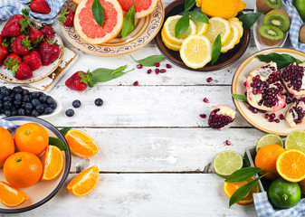 Fresh fruits and berries on a white wooden table. Healthy eating