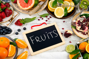 Healthy eating background. Different fruits and berries on a woo