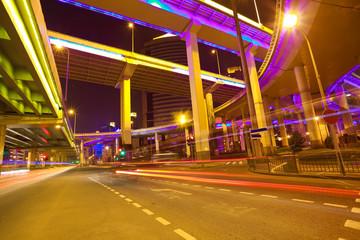 Empty road floor with city elevated bridge of night