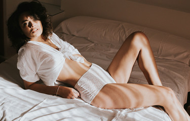 Sexy Brunette Woman on Bed