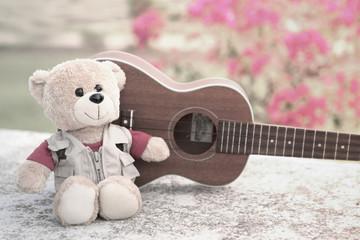 Photo vintage-style of teddy bears and ukulele.
