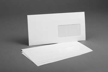 White envelope with address window on gray background.