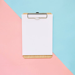 Blank clipboard on pastel color background, minimal style.
