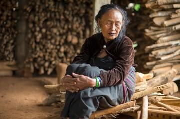 Senior woman in hut, Shan State, Keng Tung, Burma