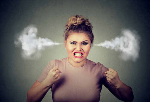 angry woman blowing steam coming out of ears about to have nervous breakdown screaming
