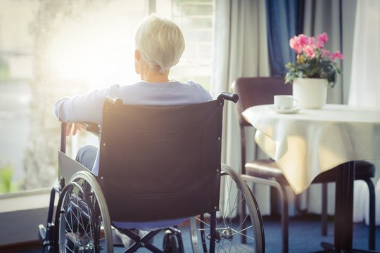 Rear view of senior woman senior woman sitting on wheelchair
