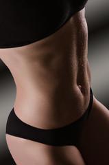 Female sexy body in black underwear.  Woman body care.