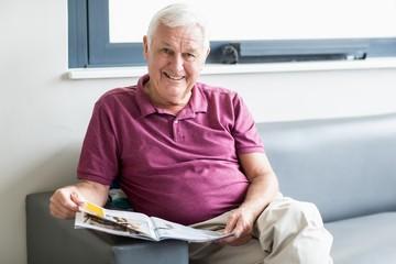 Senior man reading the newspaper